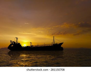 Silhouettes, Sea Cargo Ship at sunset.