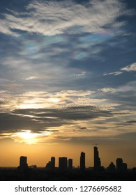 Silhouettes of the skyscrapers in downtown Bangkok cityscapes, the capital of Thailand in southeast Asia, with golden sunshine at sunset in summer in vertical view.