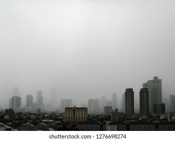 Silhouettes of the skyscrapers in downtown Bangkok cityscapes, the capital of Thailand in southeast Asia, with raining in horizontal view.