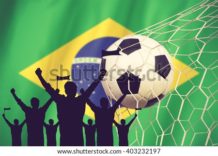 silhouettes of Soccer fans with flag of brazil .Cheer Concept vintage color