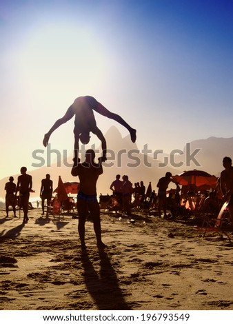 a6391edfce8b3b Silhouettes of someone doing a flip above sunset beach scene at Ipanema  Beach Rio de Janeiro