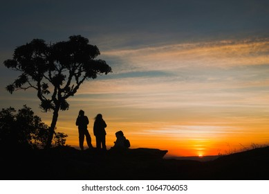 Silhouettes at sunset in Brazil