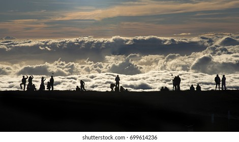 Silhouettes of sunset viewers at Haleakala