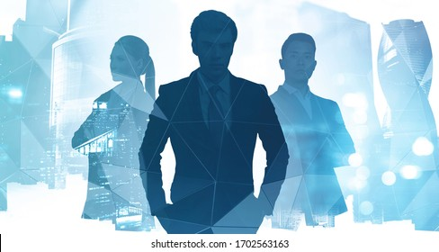 Silhouettes of three diverse confident business people working together in abstract blurry city with creative double exposure effect. Concept of leadership. Toned image