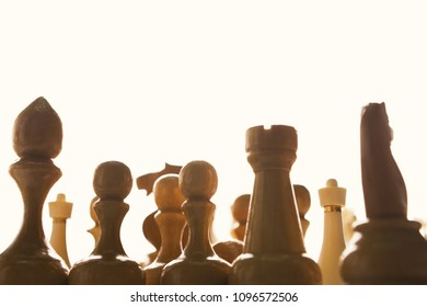 Silhouettes of white chess figures on white background, business and crowd concept, copy space