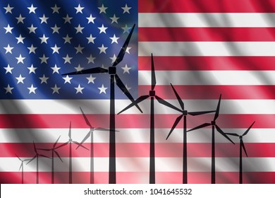 Silhouettes of wind generators against the background of the flag of United States