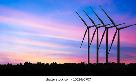 silhouettes Wind turbine power generators at sunset, Alternative renewable energy production