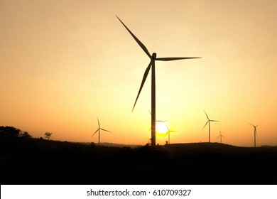 Silhouettes wind turbine with sunset.
