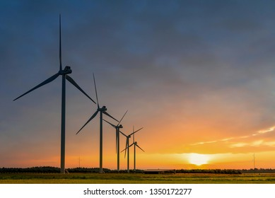 Silhouettes of windmills, Denmark. Alternative sources of energy.