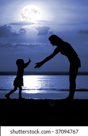 Silhouettes of the women and child on moon night