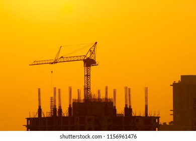 SilhouetteTower crane on construction site at sunset in Thailand