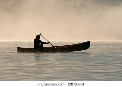 Silhoutte of a canoeist on Burnt Island Lake - Ontario, Canada