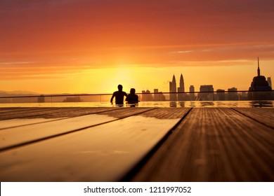 silhoutte of couple at kuala lumpur rooftop swimmingpool