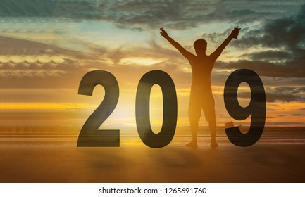 Silhoutte Freedom traveller hold the hand celebrate new year 2019 on beach sunset