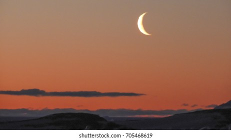 Silhoutte and view of moon at Antarctica. This picture was taken at Larsemann hills , Antarctica on 05-29-2017.