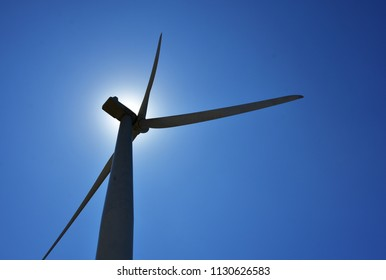 silhoutte of a windmill against the midday sun