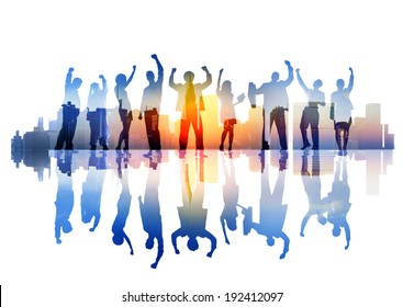 Silhouttes of Celebrating Business People on a CityScape
