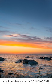 Silhouttes of stones with sunset in the background