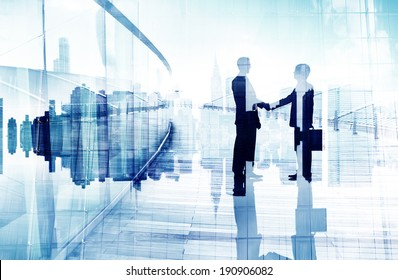Silhouttes of Two Business People Having a Handshake