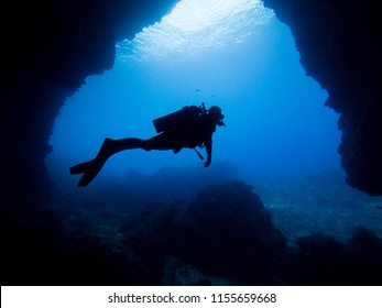 Silhuette of a diver in an underwater cave