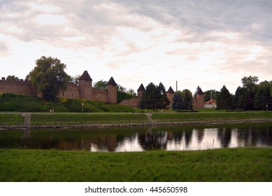 Silhuette of town fortification and church of St. Giles in Nymburk, Czech republic at afterglow. View from riverside