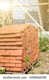 silicate bricks are stacked in pile on pallet and ready for construction