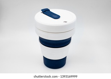 Silicon collapsible cup on a gray background.