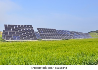silicon solar energy batteries on green meadow