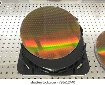Silicon wafers on black box,Silicon wafers colors reflect light in a variety of colors colorful and beautiful. Semiconductor
