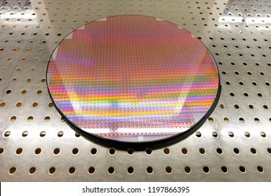 Silicon wafers on table waiting for inspection, wafers Colors reflect light in a variety of colors colorful and reflection. Semiconductor