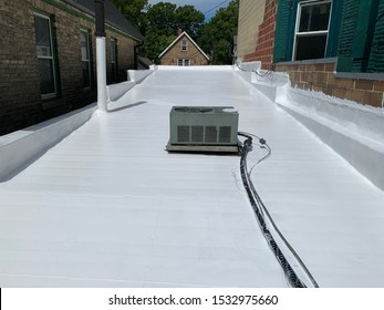 silicone coating applied to a flat rubber membrane roof.
