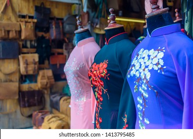 Silk Ao Dai (traditional Vietnamese dresses)  on display at one of the many made-to-order tailors shop in Hoi An, Vietnam