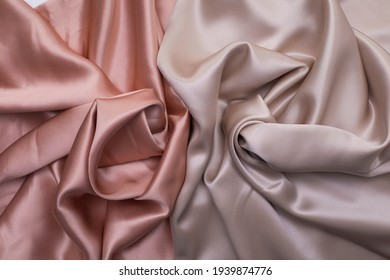 Silk bed sheets texture, pink silk fabric with decorative pleats