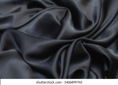 Silk fabric, cadi, black color in the artistic layout