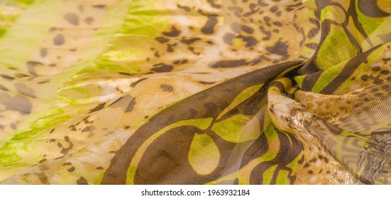 silk fabric, green-brown, abstract background luxury cloth or liquid wave or wavy folds of grunge silk texture satin velvet material or luxurious Christmas background or elegant wallpaper design