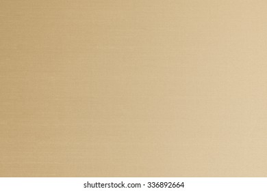 Silk fabric wallpaper texture background in antique yellow light cream beige gold brown color