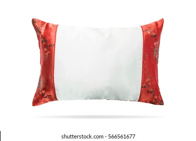 Silk pillow in china style on isolated background with clipping path. Elegant headboard for montage or your design.