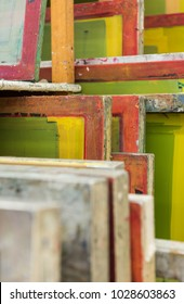 Silk screen printing screens stored in a wooden rack ready for printing. Hand screen printing is back in fashion.