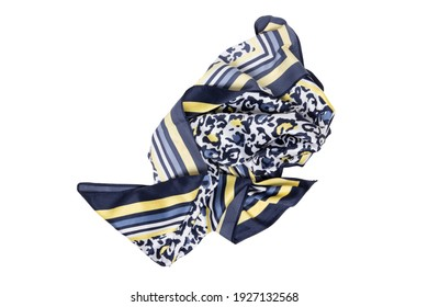 Silk shawl isolated. Closeup of a beautifully folded multicolored blue yellow silk scarf or headscarf with a pattern isolated on a white background.