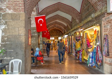 Silk shops that sell silk clothes, shawls and clothes in Koza Han Silk Bazaar. Koza Han is historical place from Ottoman. - Shutterstock ID 1561659529