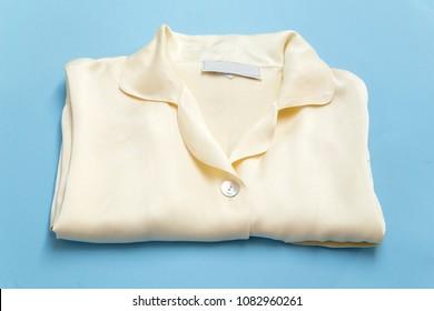 Silk sleepwear on blue background