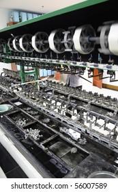 Silk spinning machine close-up at silk mill