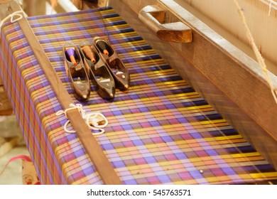 Silk and thread of yarn on traditional loom