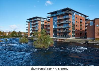 SILKEBORG, DENMARK - OCTOBER 30, 2017: Apartment buildings on the quay of the famous danish river Gudenaaen where it runs through the city SIlkeborg