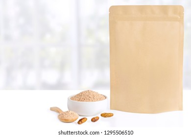 Silkworm Pupae (Bombyx Mori) powder. Insects flour for eating as food items made of cooked insect meat in bowl and spoon with package bag, it is good source of protein edible. Entomophagy concept.