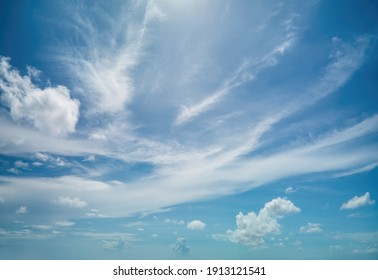 Silky blue sky with soft clouds