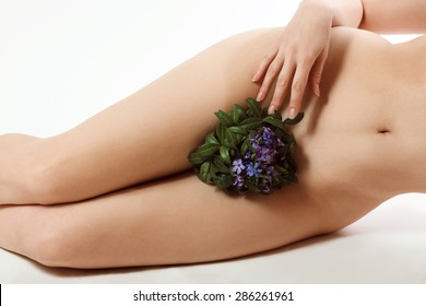 silky female skin with bouquet of blue flowers