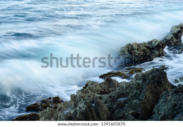 silky-movement-waves-crashing-against-60