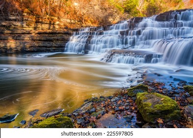 Silky water cascades over limestone rock at Burgess Falls State Park in Tennessee.