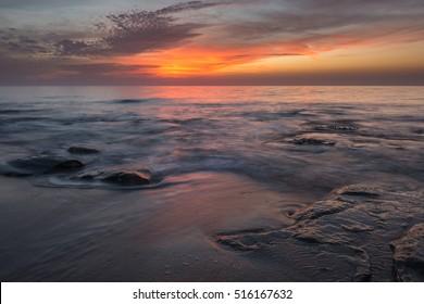silky water on a vivid orange sunset